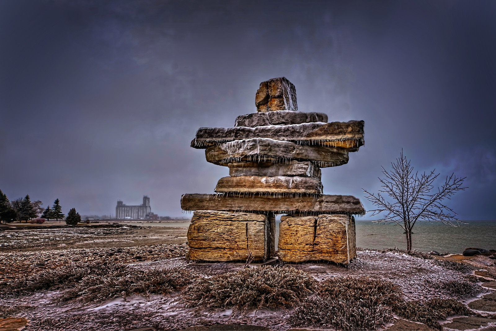 Inuksuk during freezing rain in collingwood